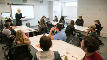 Students listen to Professor Flanagan in a Game Theory class.